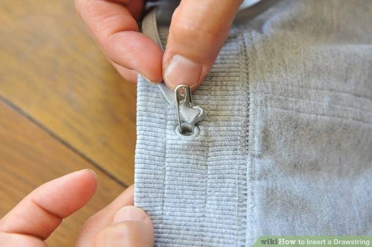Réinsérer un cordon avec une épingle